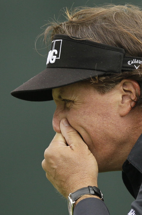 Phil Mickelson reacts after missing a putt on the 10th green during the first round of the U.S. Open Championship golf tournament Thursday, June 14, 2012, at The Olympic Club in San Francisco. (AP Pho