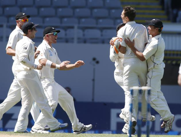 New Zealand celebrate Boult dismissing India's Rahane on day four of the first international test cricket match at Eden Park in Auckland