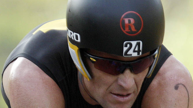 FILE - In this Feb. 12, 2012, file photo, Lance Armstrong competes in the Ironman Panama 70.3. triathlon in Panama City, Panama. The U.S. Anti-Doping Agency is bringing doping charges against the seven-time Tour de France winner, questioning how he achieved those famous cycling victories.  Armstrong, who retired from cycling last year, could face a lifetime ban from the sport if he is found to have used performance-enhancing drugs. He maintained his innocence, saying: