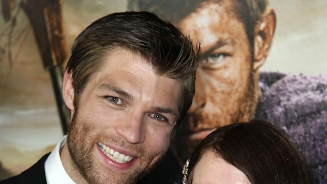 "Liam McIntyre, left, and Erin Hasan arrive at the premiere of ""Spartacus: War of the Damned"" on Tuesday, Jan. 22, 2013 in Los Angeles. ""Spartacus: War of the Damned"" premieres Friday, Jan. 25 at 9PM on STARZ. (Photo by Matt Sayles/Invision for STARZ/AP Images)"