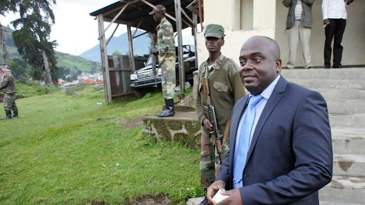 President of the political wing of the rebel group M23 Bertrand Bisimwa speaks to journalists, in front of their headquarters in Bunagana on the border of the Democratic Republic of Congo and Uganda, on April 26, 2013