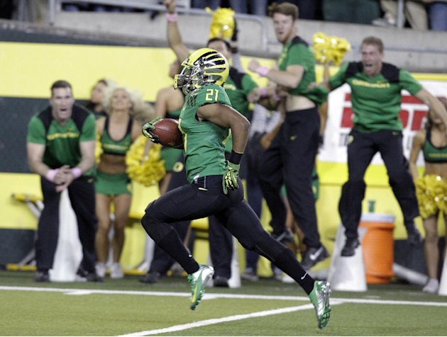 Oregon defender Avery Patterson runs for a touchdown after intercepting a pass during the first half of an NCAA college football game against Washington in Eugene, Ore., Saturday, Oct. 6, 2012. (AP Ph