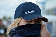A woman wears the logo of European aerospace giants EADS on her hat at an airshow near Berlin on September 13. Germany has serious doubts over a proposed merger between EADS and BAE Systems, according to a parliamentary commission report that cites concerns on the future of European sites, German news agency DPA reported