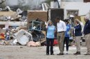 U.S. President Obama surveys damage with Plaza Tower Elementary School Principal Amy Simpson in Moore, Oklahoma