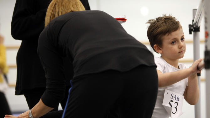 Griffin Horton, 5, of New York, is evaluated during an audition for six-year old ballet hopefuls at the School of American Ballet, Friday, April 5, 2013 in New York.  (AP Photo/Jason DeCrow)