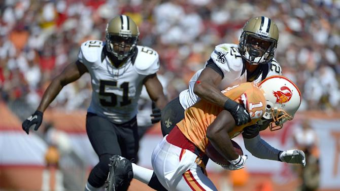 New Orleans Saints cornerback Patrick Robinson (21) takes down Tampa Bay Buccaneers wide receiver Mike Williams (19) as Saint's linebacker Jonathan Vilma (51) moves in during the second quarter of an NFL football game Sunday, Oct. 21, 2012, in Tampa, Fla. (AP Photo/Phelan Ebenhack)