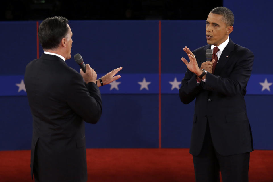 Republican presidential nominee Mitt Romney  and President Barack Obama spar over energy policy during the second presidential debate at Hofstra University, Tuesday, Oct. 16, 2012, in Hempstead, N.Y. (AP Photo/Charlie Neibergall)