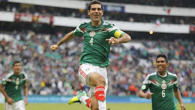 In this Nov. 13, 2013 file photo, Mexico's Rafael Marquez celebrates after scoring his team's 5th goal during a 2014 World Cup playoff first round match against New Zealand in Mexico City. If nothing unexpected happens, Marquez will be only the second Mexican to appear in four World Cups