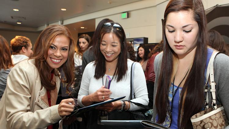 Toni Trucks signs autographs at the Time Warner Cable and Twilight Fan Breakfast on Sunday, Nov. 11, 2012 in Los Angeles. (Photo by Casey Rodgers/Invision for Time Warner Cable/AP Images)