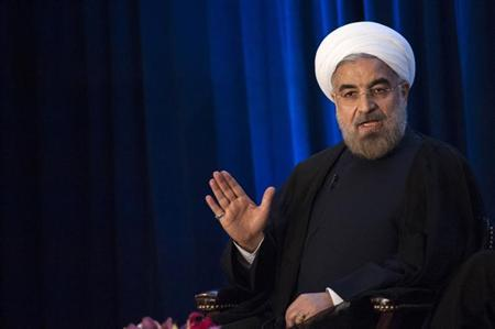 Iran's President Hassan Rohani speaks with Asia Society President and CEO Josette Sheeran during an event in New York