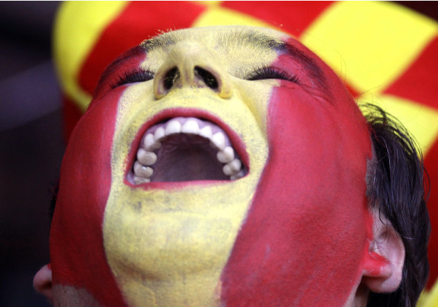A Spain supporter cheers for his team ahead of Sunday's Euro 2012 soccer championship final match between Spain and Italy in Kiev, Ukraine, Sunday, July 1, 2012.(AP Photo/Efrem Lukatsky)