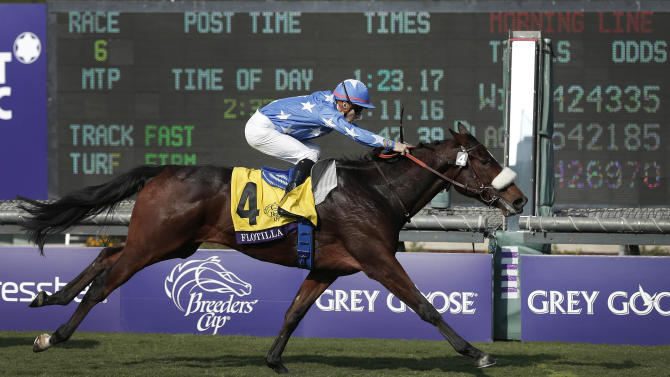 Flotilla, with jockey Christophe Lemaire up, crosses the finish line to win the Juvenile Fillies Turf horse race at the Breeders' Cup, Friday, Nov. 2, 2012, Arcadia, Calif. (AP Photo/Gregory Bull)