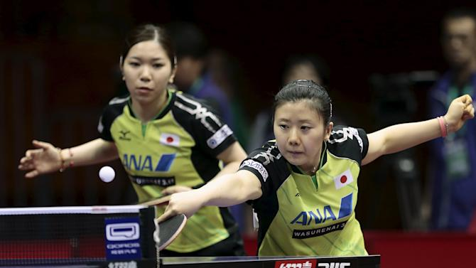 Japan's Fukuhara and Wakamiya play against Hugh and Jha of the U.S. in their women's doubles first round match at the World Table Tennis Championships in Suzhou