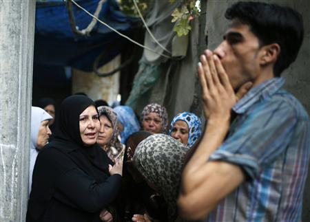 Palestinians mourn during funeral of Hamas gunman in northern Gaza