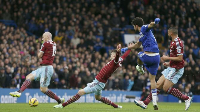 Chelsea's Diego Costa shoots to score a goal against West Ham United during their English Premier League soccer match at Stamford Bridge in London