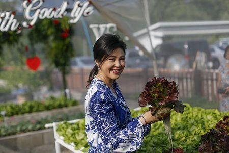 Turning over new leaf: Ousted Thai PM picks lettuce for the cameras