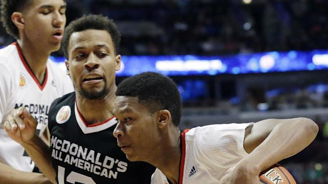 West point guard PJ Dozier, right, of Spring Valley in Columbia, S.C.,, drives as East point guard Isaiah Briscoe of Roselle Catholic in Roselle, N.J., defends during the first half of the McDonald's All-American boys basketball game in Chicago on Wednesday, April 1, 2015. (AP Photo/Nam Y. Huh)