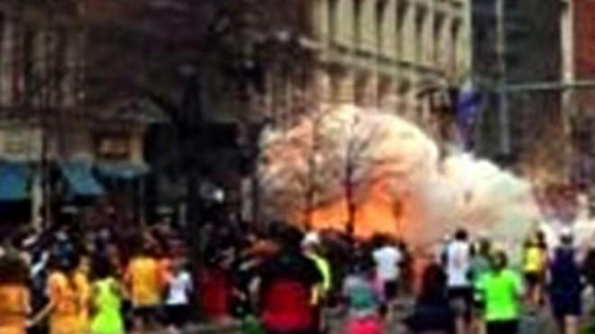 An image from a video provided by ABZ TV shows fire and smoke exploding from a building near the Boston Marathon finish line.