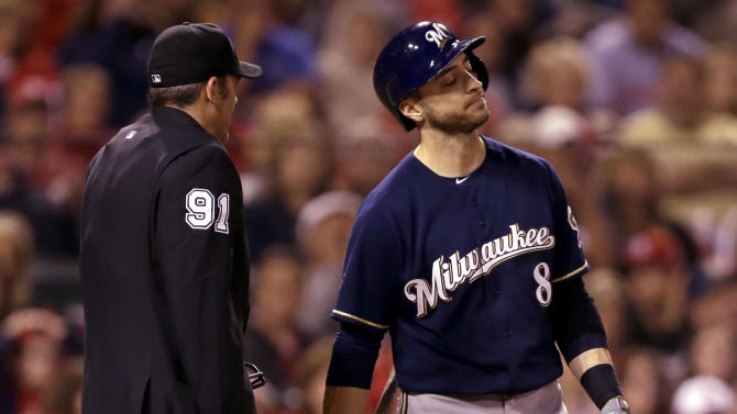 Milwaukee Brewers' Ryan Braun walks away from home plate umpire Brian Knight, left, after striking out swinging to end the top of the sixth inning of a baseball game against the St. Louis Cardinals Tuesday, Sept. 16, 2014, in St. Louis. (AP Photo/Jeff Roberson)
