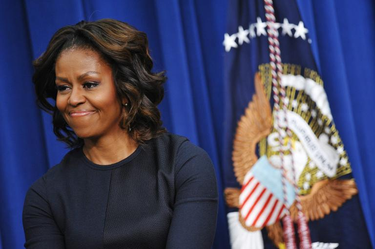 US First Lady Michelle Obama smiles during an event on January 16, 2014 in Washington, DC
