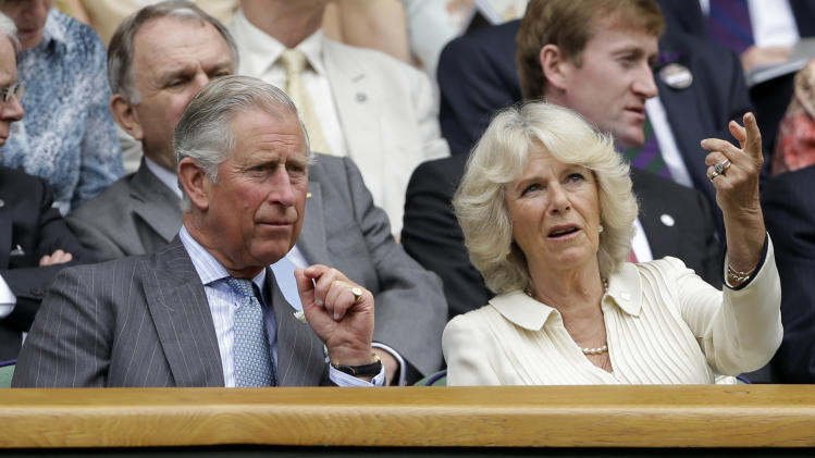 Britain's Prince Charles, left, and his wife Camilla, Duchess of Cornwall, wait in the Royal Box for the start of a second round men's singles between Roger Federer of Switzerland Fabio Fognini of Italy during a match at the All England Lawn Tennis Championships at Wimbledon, England, Wednesday, June 27, 2012. (AP Photo/Kirsty Wigglesworth)
