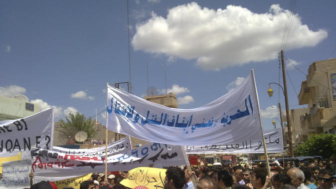 """In this citizen journalism image made on a mobile phone and acquired by the AP, Syrian anti-government protesters carry banners in Arabic that read: """"Freedom means to stop the killing and arrests,"""" during a rally in the northeastern city of Qamishli, Syria, Friday, May 13, 2011. Syrian soldiers occupied mosques and blocked off public squares Friday, but thousands of people managed to hold demonstrations anyway as the regime carries out one of the most brutal crackdowns since a wave of popular revolts began sweeping the Arab world. (AP Photo)"""