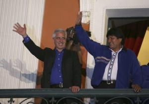 Bolivia's President Evo Morales and Vice President Alvaro Garcia Linera wave to supporters from the presidential palace balcony in La Paz,