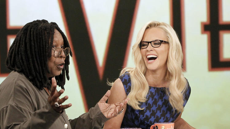 "This image released by ABC shows co-hosts Whoopi Goldberg, left, and Jenny McCarthy during a broadcast of ""The View,"" Monday, Sept. 9, 2013 in New York. (AP Photo/ABC, Lou Rocco)"