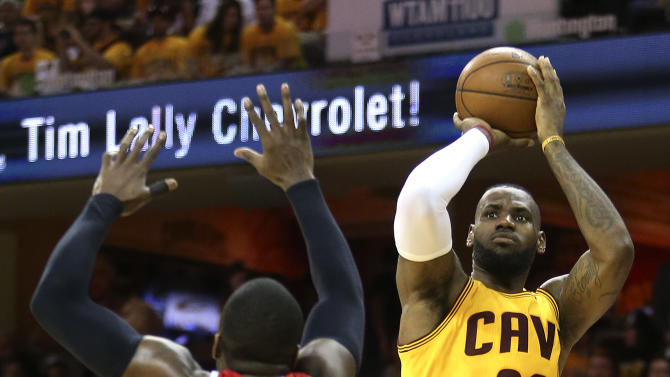 Cleveland Cavaliers forward LeBron James (23) shoots against Atlanta Hawks forward Paul Millsap (4) in the first half of Game 4 of the NBA basketball Eastern Conference Finals, Tuesday, May 26, 2015, in Cleveland. (AP Photo/Ron Schwane)