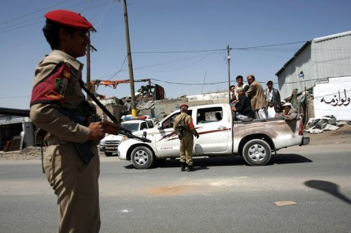Yemeni soldiers guard a checkpoint on the outskirts of Sanaa in May 2012. Yemeni security forces have foiled a plot to carry out 10 suicide bombings against government buildings in the capital Sanaa, the defence ministry's news website reported on Monday