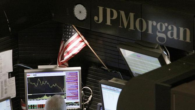 A trader works in the J.P. Morgan stall on floor of the New York Stock Exchange