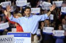 Republican Vice Presidential candidate Paul Ryan and his wife Janna wave as they arrive to a campaign event, Saturday, Sept. 29, 2012 in Derry, N.H. (AP Photo/Jim Cole)