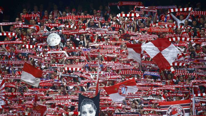Bayern Munich supporters hold up a mock championship trophy prior to Bundesliga first division soccer match against Hertha Berlin in Munich