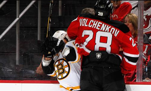 New Jersey Devils' Anton Volchenkov delivers an elbow to the head of Boston Bruins' Brad Marchand
