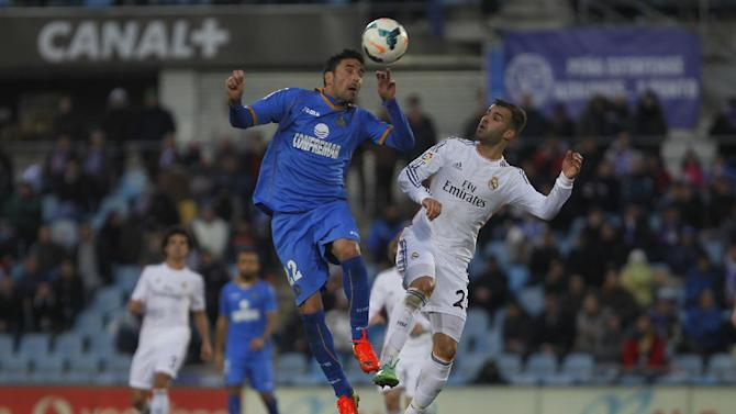 Real's Jese Rodriguez, right, in action with Getafe's Juan Rodriguez, left, during a Spanish La Liga soccer match between Real Madrid and Getafe at the Coliseum Alfonso Perez stadium in Madrid, Spain, Sunday, Feb. 16, 2014
