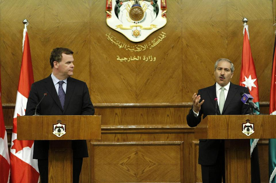 Jordanian Foreign Minister Nasser Judeh, right,  and his Canadian counterpart John Baird are seen during a press conference following their meeting in Amman, Jordan, Saturday, Aug. 11, 2012. (AP Photo/Raad Adayleh)