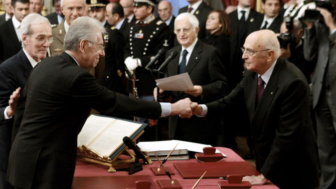 RETRANSMISSION FOR IMPROVED TONING - Mario Monti, left, shakes hands with Italian Premier Giorgio Napolitano after been officially sworn in as Italian premier, at the Quirinale Presidential palace, in Rome, Wednesday, Nov. 16, 2011. Premier Mario Monti formed a new Italian government without a single politician Wednesday, drawing from the ranks of bankers, diplomats and business executives tasked with ensuring the country escapes looming financial disaster. (AP Photo/Gregorio Borgia)