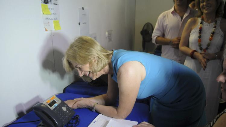 Chilean presidential candidate Evelyn Matthei of the ruling conservative right-wing bloc talks on the telephone with a supporter, during a campaign event in Santiago