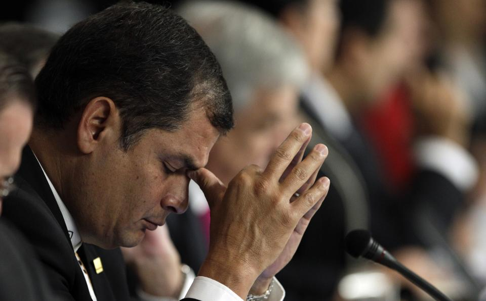 Ecuador's President Rafael Correa attends a Mercosur summit in Mendoza, Argentina, Friday, June 29, 2012. (AP Photo/Natacha Pisarenko)