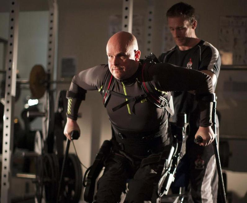 Exoskeleton lets paralysed man walk again using his own muscles