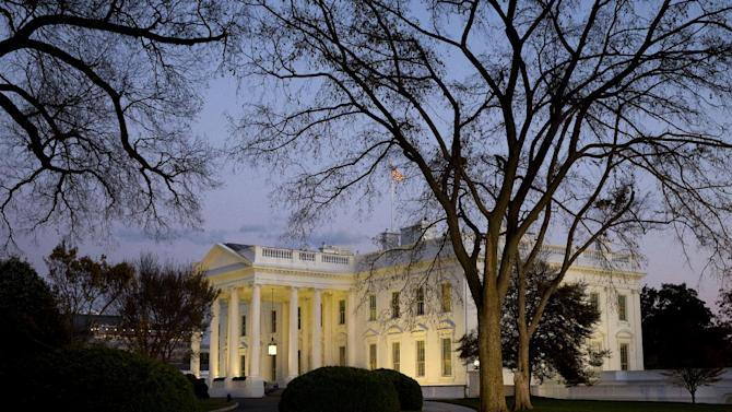 """FILE - This Nov. 20, 2014, file photo shows the White House at sunset in Washington. After taking a shellacking in the November midterm elections, many Democrats remain confident that the 2016 presidential landscape still tilts in their favor. Republicans, meanwhile, are out to disprove the idea of an enduring """"Obama coalition."""" (AP Photo/Jacquelyn Martin, File)"""