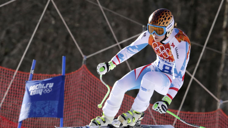 Austria's Anna Fenninger makes a jump in the women's super-G at the Sochi 2014 Winter Olympics, Saturday, Feb. 15, 2014, in Krasnaya Polyana, Russia. (AP Photo/Charles Krupa)