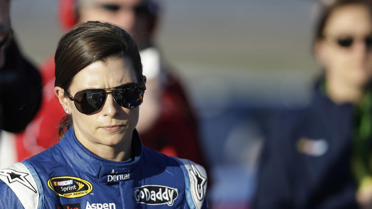 Danica Patrick walks down pit row following qualifying for Sunday's NASCAR Sprint Cup Series auto race, Friday, March 7, 2014, in Las Vegas. (AP Photo/Isaac Brekken)