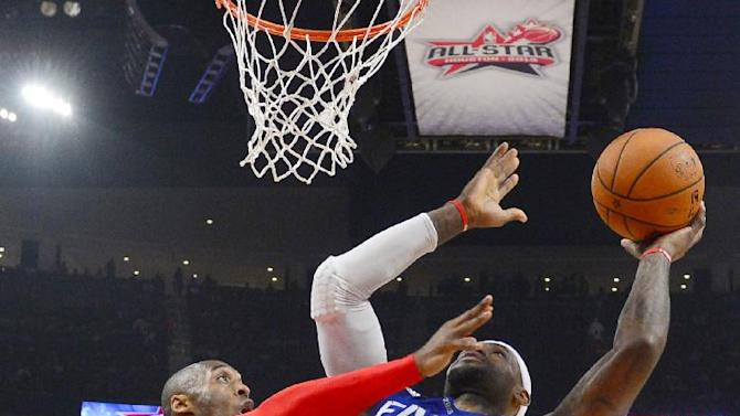 East Team's LeBron James of the Miami Heat is guarded by West Team's Kobe Bryant of the Los Angeles Lakers during the second half of the NBA All-Star basketball game Sunday, Feb. 17, 2013, in Houston. (AP Photo/Bob Donnan)