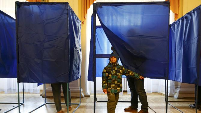 People visit a polling station during a parliamentary election in Kiev