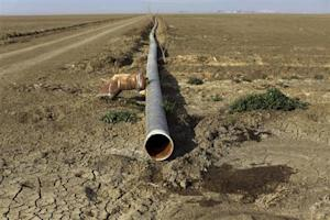 Irrigation pipe is seen on a farm near Cantua Cree …