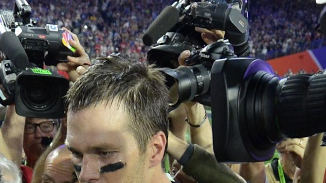 Quarterback Tom Brady of New England Patriots is surrounded by cameras following victory over the Seattle Seahawks in Super Bowl XLIX  on February 1, 2015 at University of Phoenix Stadium in Glendale, Arizona