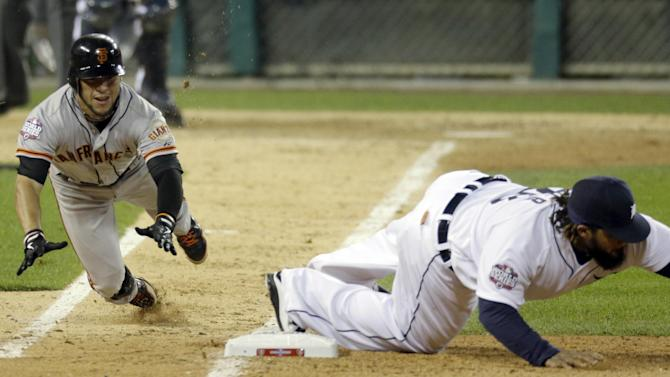 San Francisco Giants right fielder Gregor Blanco slides into the first base as Detroit Tigers first baseman Prince Fielder reaches for the ball to force Blanco out during the seventh inning of Game 3 of baseball's World Series Saturday, Oct. 27, 2012, in Detroit. (AP Photo/Carlos Osorio)