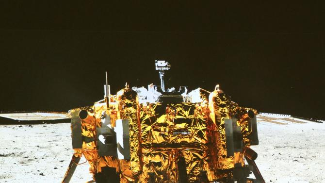 """This image taken by the on-board camera of the """"Yutu"""" or """"Jade Rabbit"""" rover, and made off the screen of the Beijing Aerospace Control Center in Beijing on Sunday, Dec. 15, 2013, shows a photo of the Chang'e-3 lander during the mutual-photograph process. The rover and the lander took photos of each other Sunday night, marking the success of the Chang'e-3 lunar probe mission. (AP Photo/Xinhua, Ding Lin) NO SALES"""