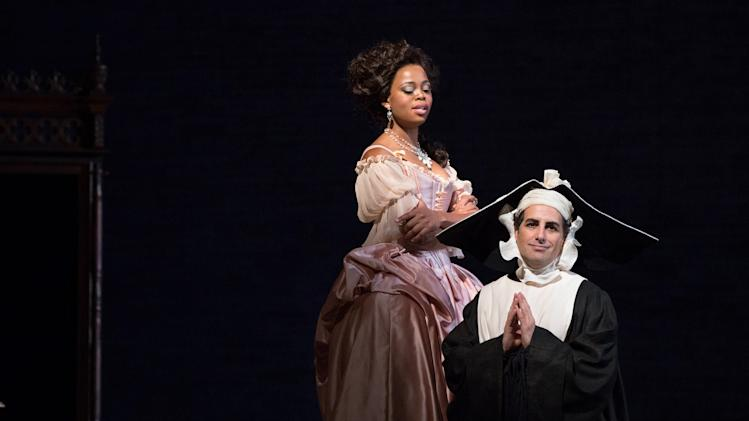 "In this Jan. 11, 2013 photo provided by the Metropolitan Opera, Juan Diego Florez, left, performs as Count Ory with Pretty Yende as Countess Adele during a dress rehearsal of Rossini's ""Le Comte Ory,"" at the Metropolitan Opera in New York. (AP Photo/Metropolitan Opera, Marty Sohl)"